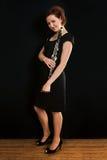 美丽的竖笛演奏者妇女 免版税库存图片