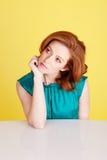 美丽的红头发人认为的妇女 库存图片