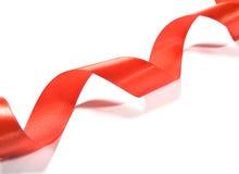 美丽的红色丝带,有益于设计。隔绝在白色背景 图库摄影