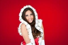 美丽的红色圣诞老人性感的妇女 库存图片