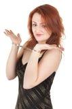 美丽的红色女孩头发的手铐 库存照片