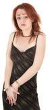 美丽的红色女孩头发的手铐 免版税库存图片