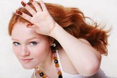 美丽的红色性感的妇女年轻人 免版税库存图片