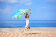 美丽的织品码头连续妇女年轻人 库存图片