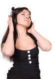 美丽的耳机妇女 免版税库存照片