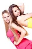 美丽的色的礼服二妇女 免版税图库摄影