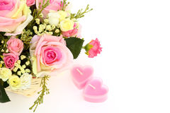 美丽的花和二个在与s的白色查出的重点蜡烛 免版税库存图片