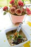 美丽的花米汤表 免版税库存图片