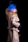 美丽的蓝色外套方式帽子模型佩带 免版税图库摄影