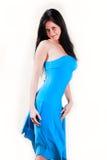 美丽的蓝色礼服妇女年轻人 免版税库存图片
