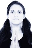 美丽的蓝色递凝思祷告妇女年轻人 免版税库存照片