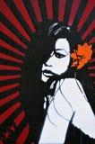 美丽的街道画钢板蜡纸妇女 免版税库存照片
