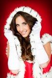 美丽的衣裳圣诞老人性感的佩带的妇&# 免版税库存图片