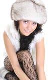 美丽的裘皮帽坐的妇女 图库摄影