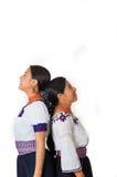 美丽的西班牙穿传统安地斯山的衣物,两个的母亲和女儿站立与摩擦反对的后面 图库摄影