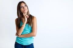 美丽的认为的妇女年轻人 查出在白色 免版税库存图片