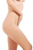 美丽的赤裸妇女。大腿用手。 免版税图库摄影