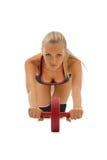 美丽的金发碧眼的女人执行体操做 免版税库存照片
