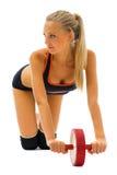 美丽的金发碧眼的女人执行体操做 免版税库存图片