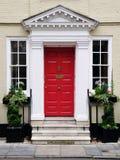 美丽的门前面房子 免版税库存照片