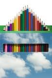 美丽的颜色铅笔,推出从云彩箱子 免版税库存照片