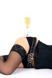 美丽的香槟玻璃臀部 图库摄影