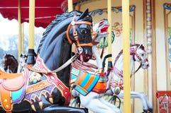 美丽的马转盘在假日公园 库存照片