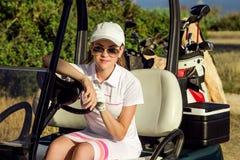 美丽的高尔夫球女孩画象  库存图片