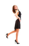 美丽的黑色礼服妇女年轻人 免版税库存照片
