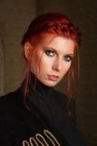 美丽的头发的红色妇女 库存图片