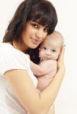 美丽的婴孩她的母亲 库存图片