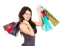 美丽的年轻浅黑肤色的男人微笑的妇女购物 库存照片