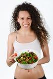 美丽的年轻混杂的妇女用沙拉,隔绝在白色 免版税库存照片