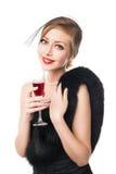 美丽的玻璃红葡萄酒妇女 减速火箭的样式 免版税库存图片