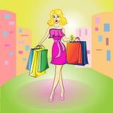 美丽的年轻白肤金发的妇女去商店 库存照片