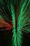 美丽的经线蠕虫红色和绿色五颜六色的背景  库存照片