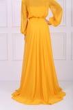 美丽的黄色礼服 免版税图库摄影