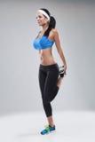 美丽的年轻跑步的妇女。隔绝在白色背景(c 免版税库存图片