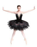 美丽的ballerine在releve芭蕾位置站立 库存照片