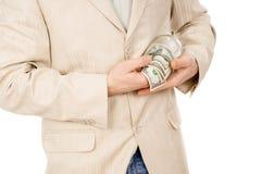 美丽设法一个年轻的人从玻璃conta提取金钱 免版税库存图片