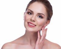美丽面对她感人的妇女年轻人 新鲜的健康皮肤 查出在白色 图库摄影