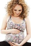 美丽鼓起她可爱的怀孕的感人的妇女 库存图片
