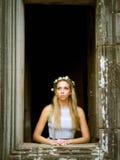 美丽,孤独的童话公主Looking Out塔窗口 免版税库存图片