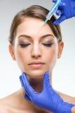 美丽,至善至美的女性面孔-整容手术,射入 免版税库存照片