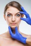 美丽,至善至美的女性面孔-整容手术 免版税库存照片