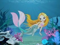 美人鱼和海豚背景 免版税库存图片