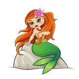 美人鱼坐岩石 库存图片