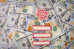 美元与圣诞节元素的笔记 库存照片