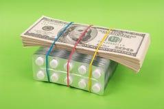 美元位置包装空白装箱的片剂 免版税库存图片
