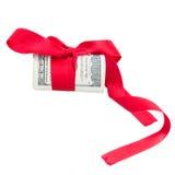 美元卷与红色弓的 免版税图库摄影